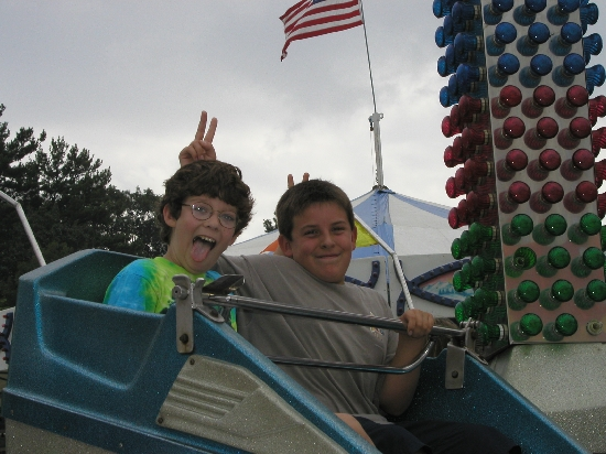 "My son and his best friend Michael at the fair.  They got their hands stamped in one of those ""all you can ride"" deals 'til 3pm and they just went nuts.  They had a great time, ate too much fair food, spent too much money on the fair games, a good typical day at the county fair."